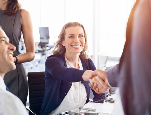 Woman shaking hands with another businessperson